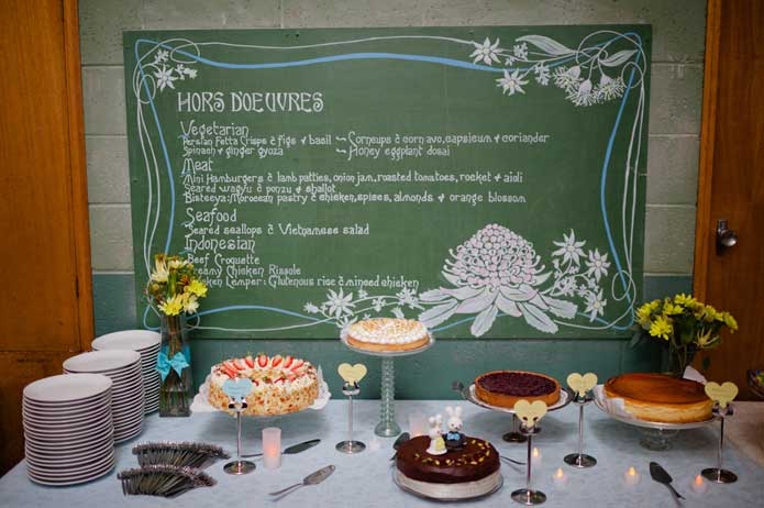 Vintage handmade wedding chalkboard menu and cake buffet table
