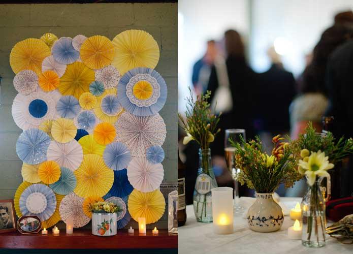 Vintage handmade wedding paper pinwheel backdrop and floral arrangements
