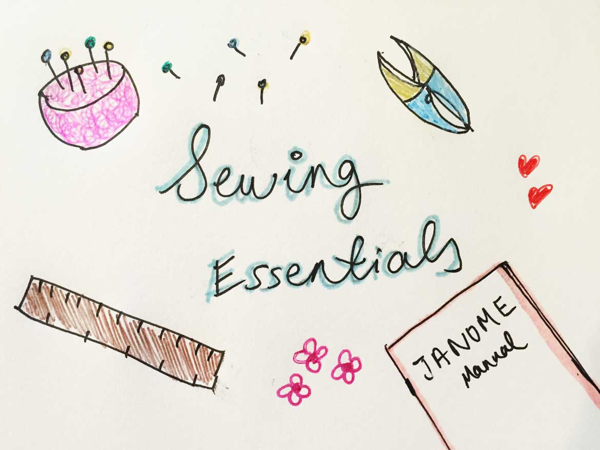 My sewing essentials: pins, pin cushion, thread clipper, ruler and my sewing machine manual!