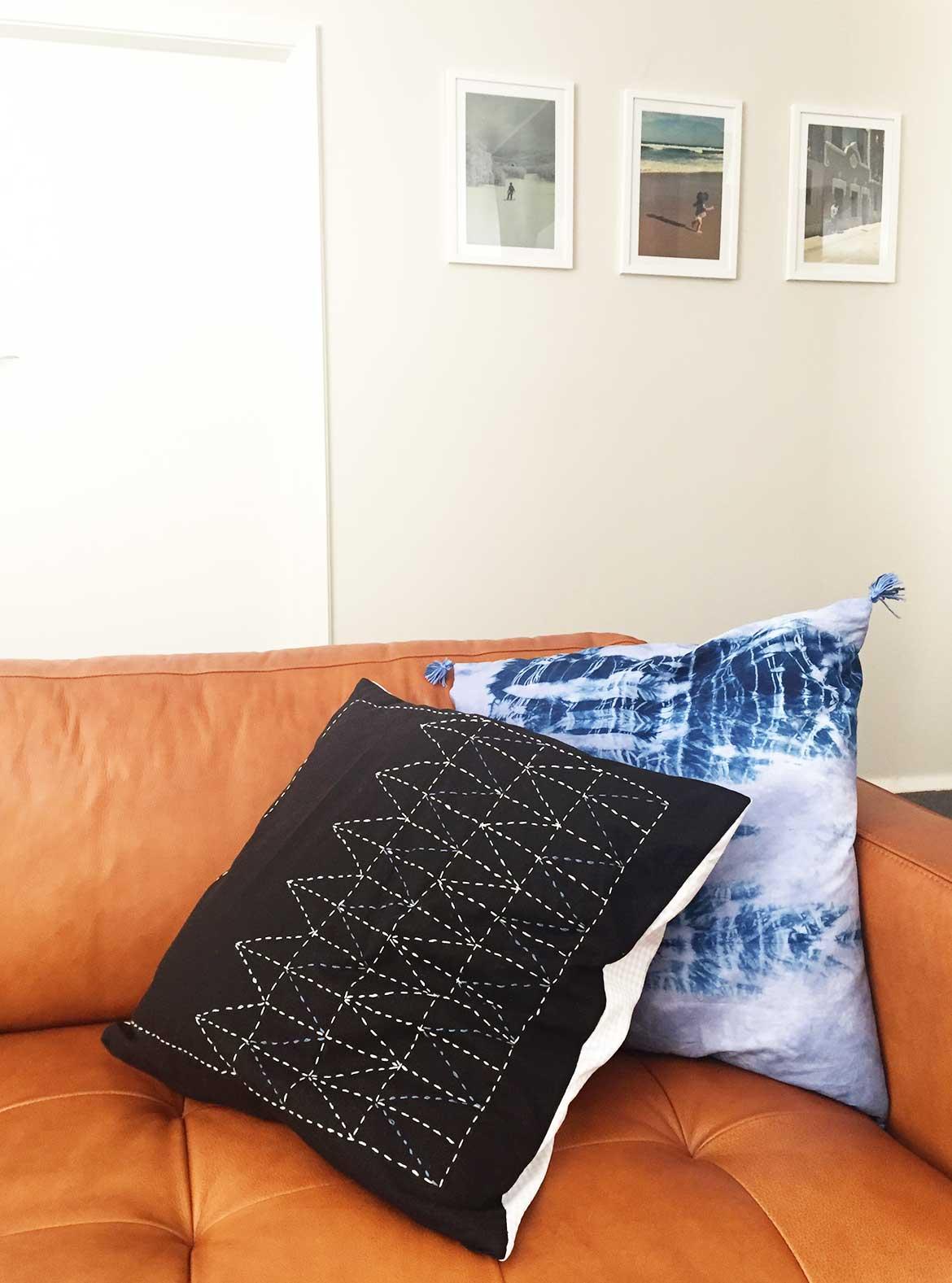 Sashiko cushion on black linen and Shibori cushion with tassels. I made both of these for my new caramel leather sofa.