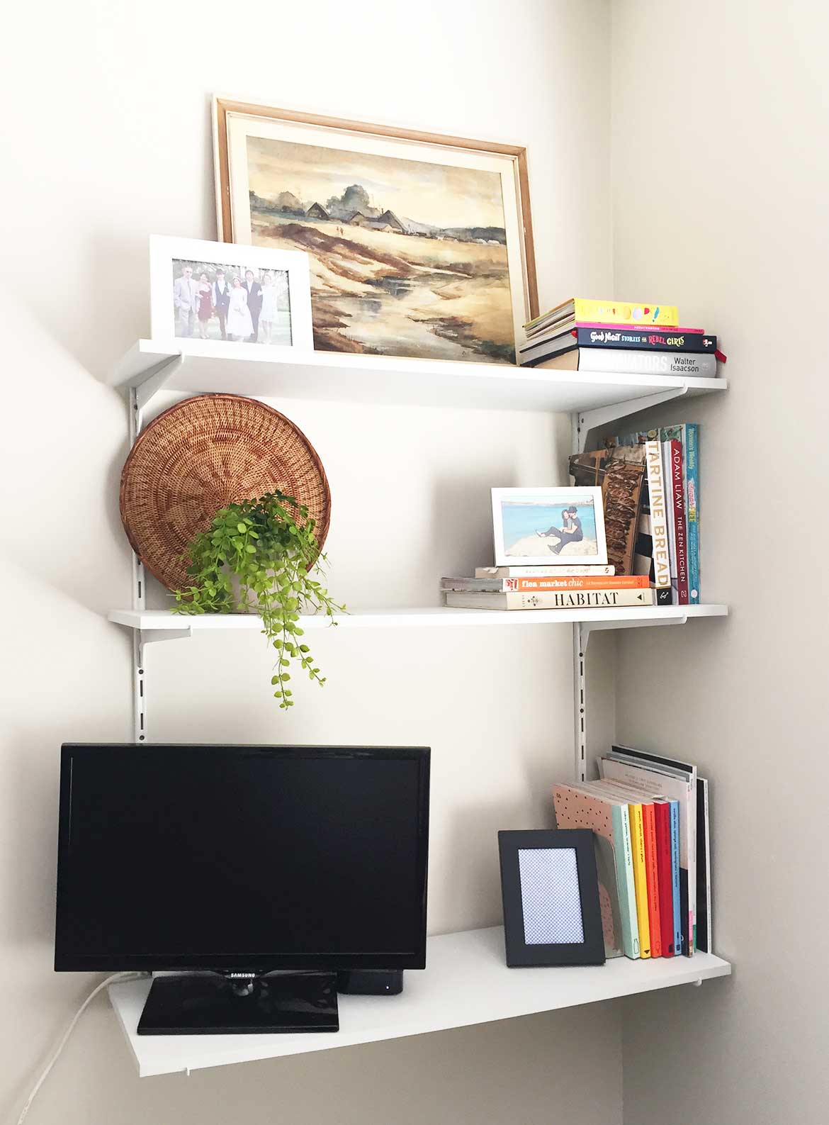 Wall shelves in our living room houses the TV as well as favourite books on rotation.