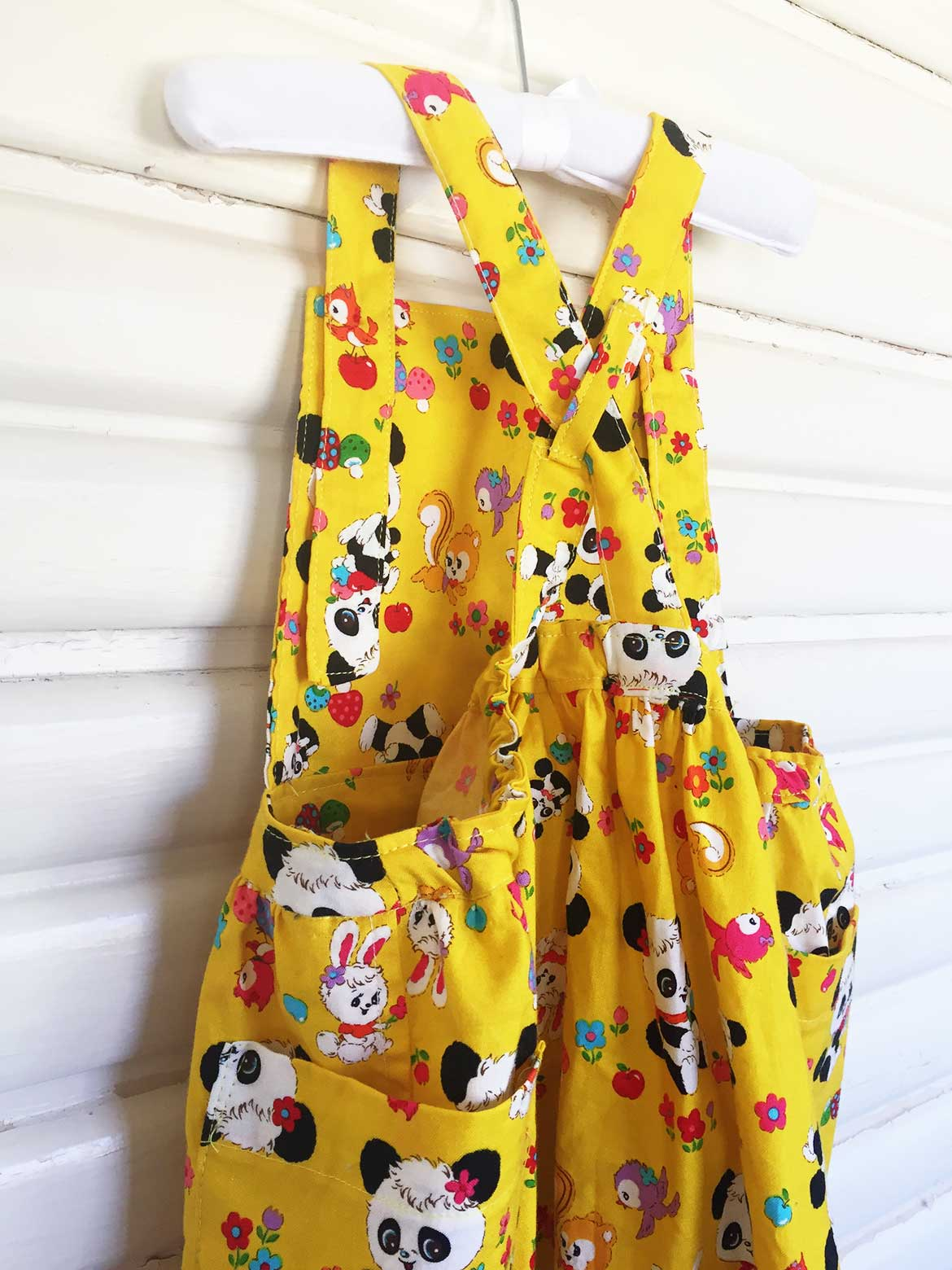 Kids Apron Dress Sewing Pattern | This adorable pinafore apron dress is from the Japanese sewing pattern book, A Sunny Spot. I made it out of a panda print fabric for my daughter's second birthday. See more photos at www.sewinlove.com.au